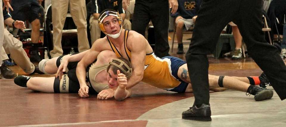 Massapequa's Chris Sarro goes for the pin on