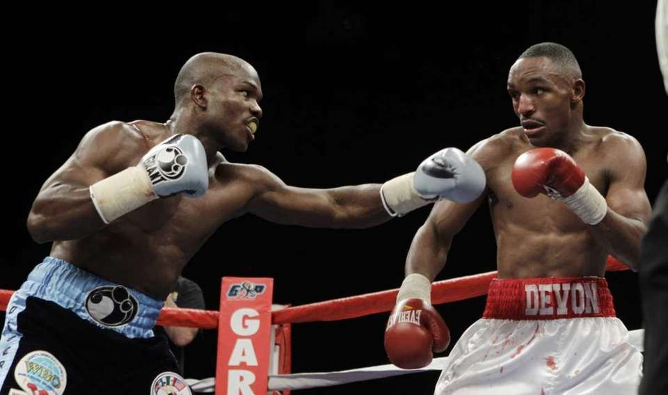 Devon Alexander, right, and Timothy Bradley fight during