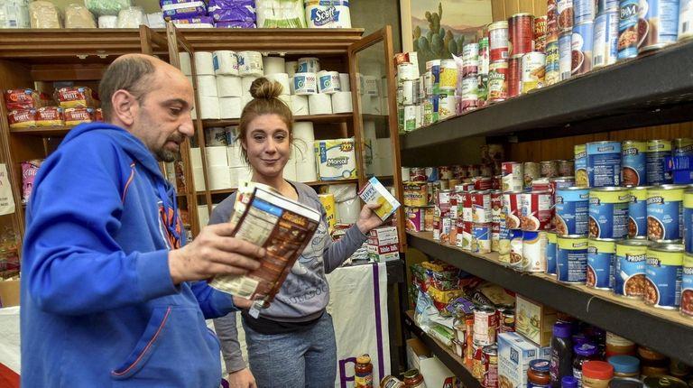 John Pantijaras and Tasha Chiuchiolp stack shelves at