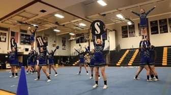 The Centereach High School varisty cheerleaders perform their