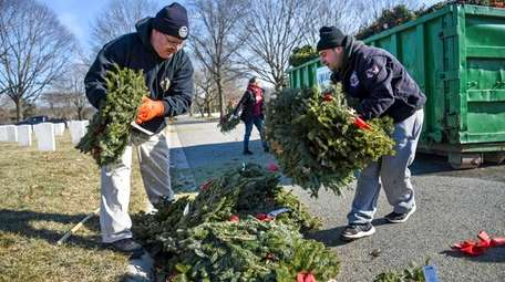Seasonal wreaths that had been placed on veterans'