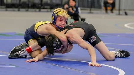 Massapequa's Anthony Conetta and Hilton's Gregor McNeil wrestle
