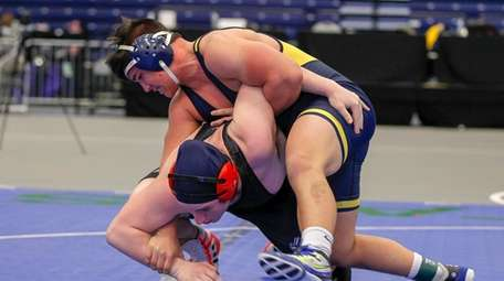 Massapequa's Angelo Petrakis controls Hilton's Jacob Cretelle during
