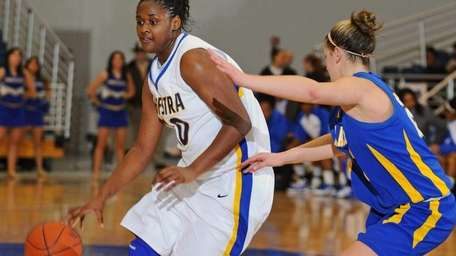Hofstra University #30 Shante Evans, left, looks to
