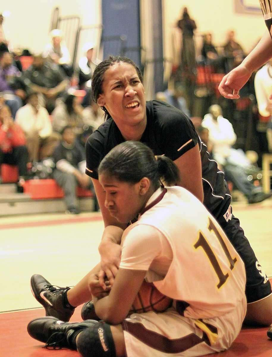 St. Anthony's Symone Kelly fights for possession during