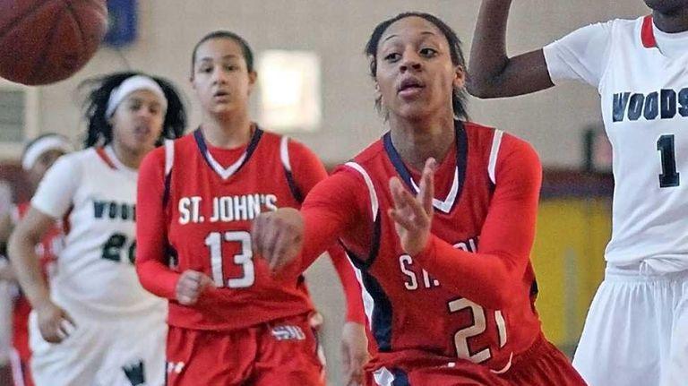 St. John the Baptist's Alexis Smith passes the