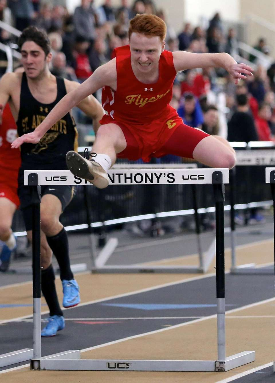 Chaminade's Matt Lally wins the boys 55m hurdles,