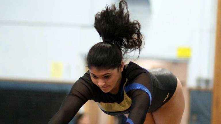 Lawrence's Nicole Caporusso during a gymnastics meet against