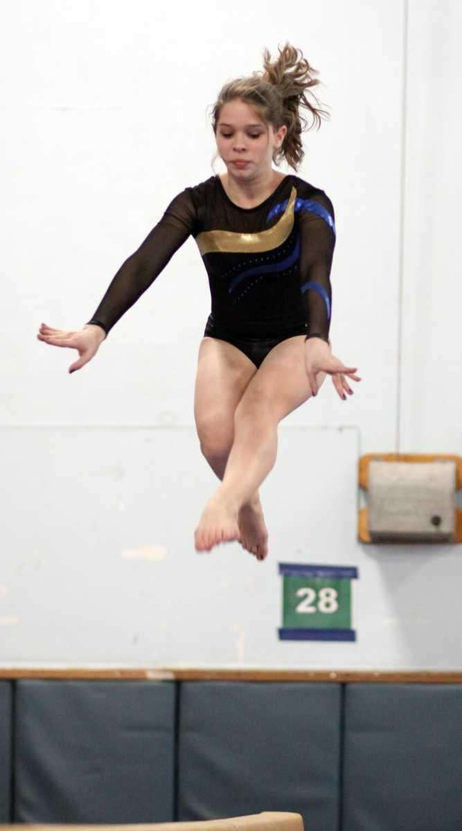 Lawrence's Taylor Luck performs on the balance beam