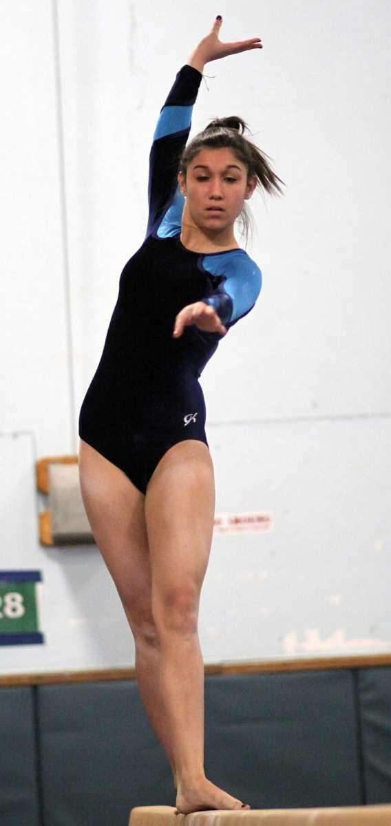 Massapequa's Jessica Romano performs on the balance beam