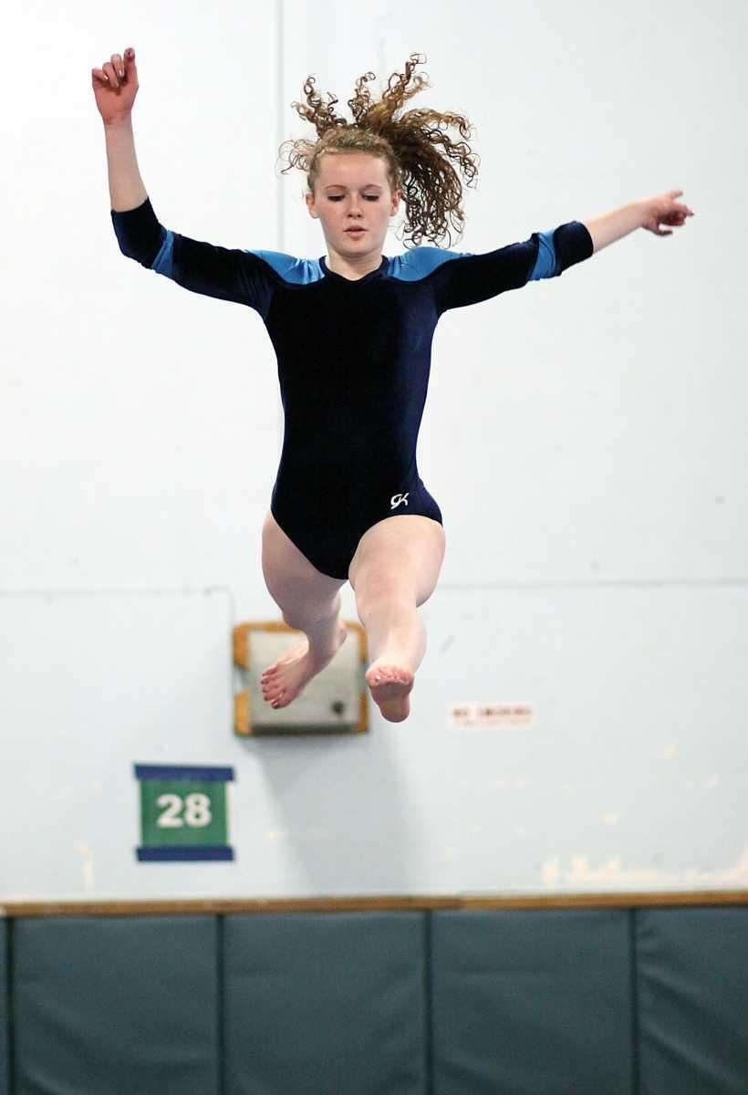 Massapequa's Kate Wall leaps into the air during