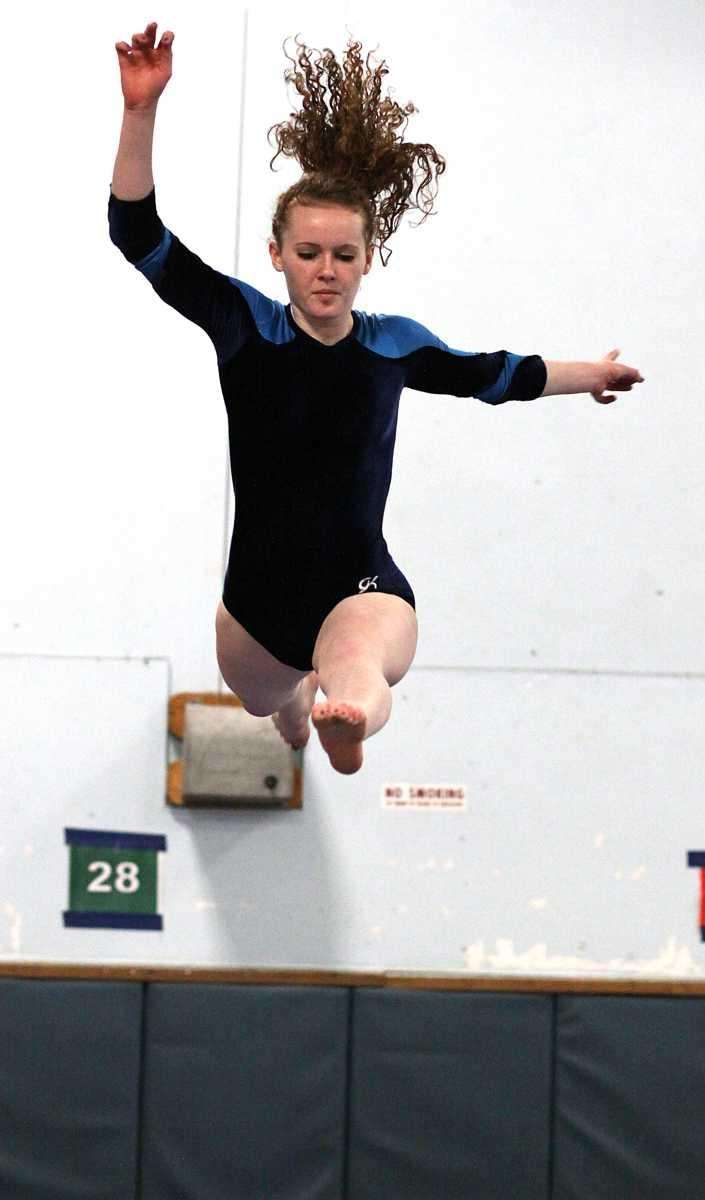 Massapequa's Kate Wall performs during a meet against