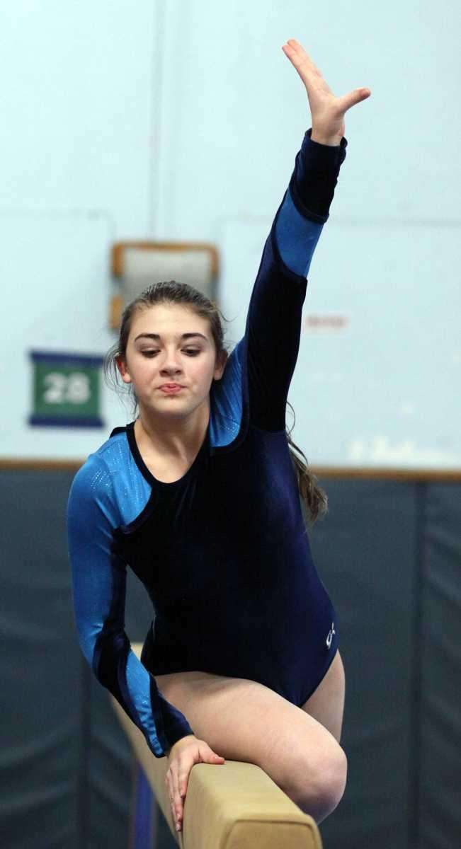 Massapequa's Brianna Saba performs on the balance beam.