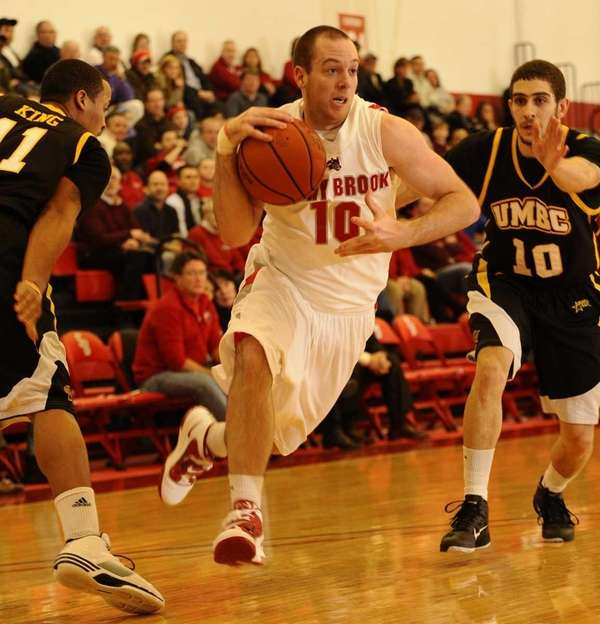 Stony Brook's Bryan Dougher drives past UMBC's Chris