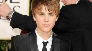 Justin Bieber arrives at the 68th Annual Golden