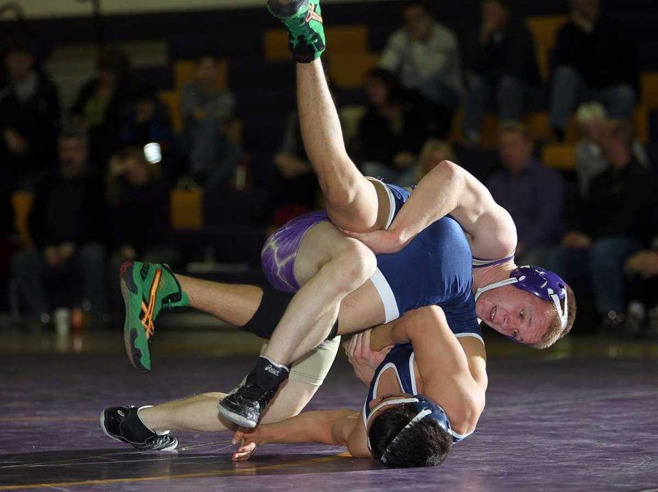 Sayville's Justin Bonamico rolls Huntington's Kevin Mendez to