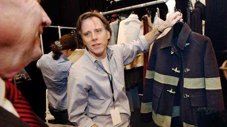 Designer Charles Nolan, right, shows a fireman-inspired wool