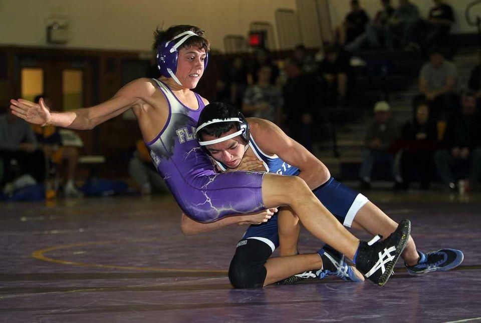 Huntington's Brandon Mendez completes a single leg takedown
