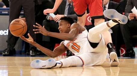 Knicks' Frank Ntilikina, bottom, steals the ball from