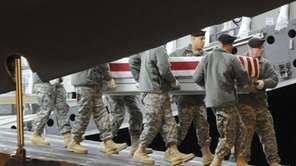 An Army team moves the remains of Sgt.