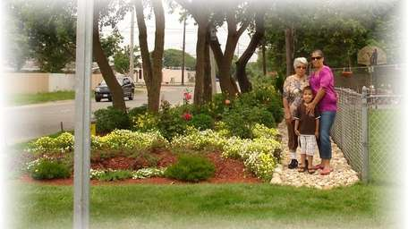 Carmen Arroyo-Santos, Lourdes Velasquez and her son Justin,