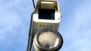 A red-light camera monitors the North Service Road