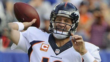 Broncos quarterback Peyton Manning looks to pass against