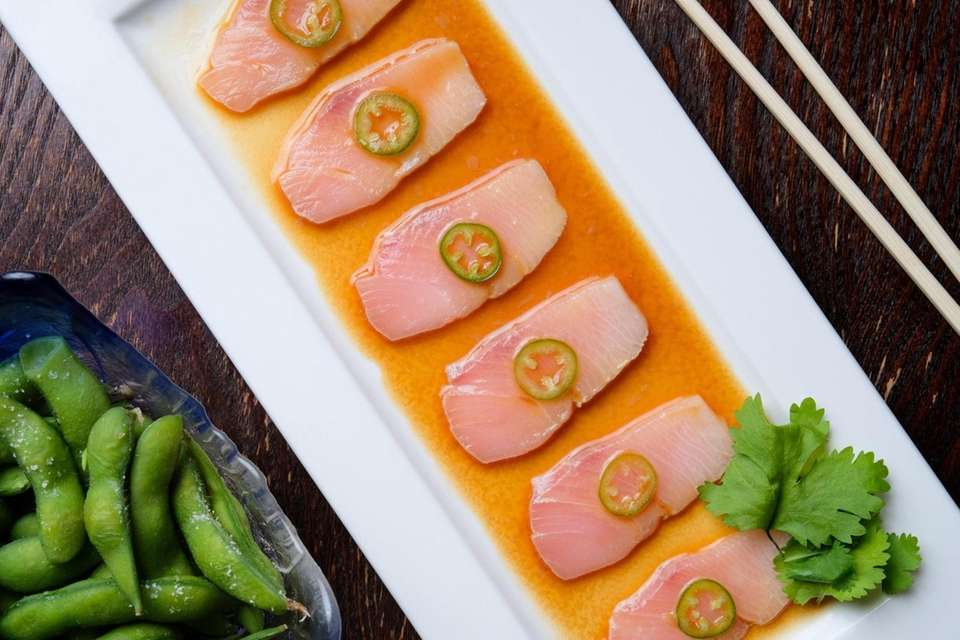 Yellow tail sashimi with jalapeno served at Nikkei