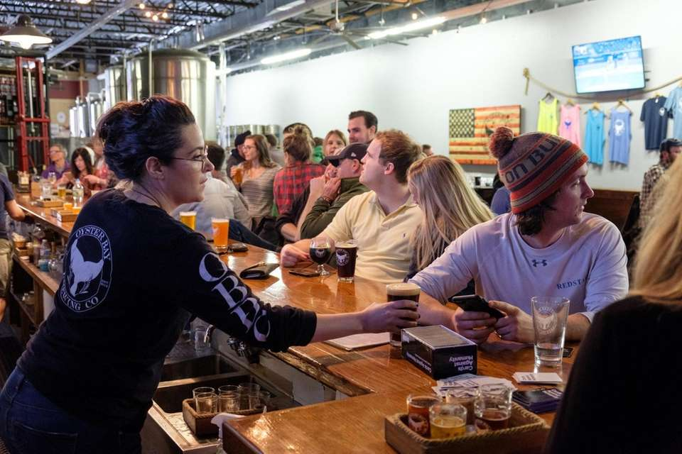 Patrons hang out and sip on a variety