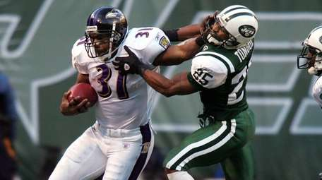 Ravens running back Jamal Lewis is run out