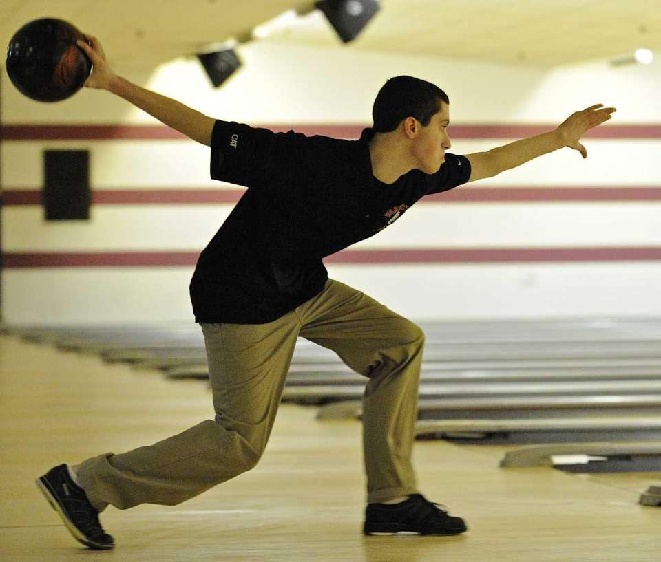 East Islip's Joe Griffin bowls in the Suffolk