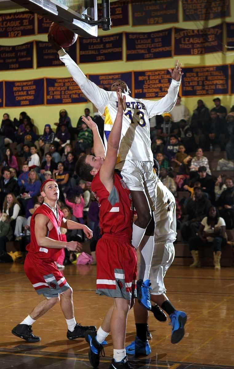 Greenport's Dantre Langhorne (13) is fouled going up
