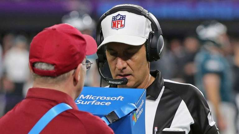 Official Gene Steratore views a replay to confirm