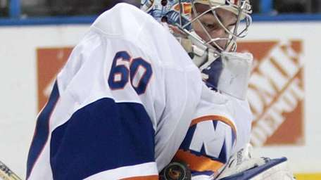 Islanders goaltender Kevin Poulin makes a save against