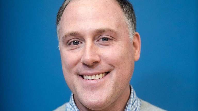 Tom Burg of Port Washington has been hired