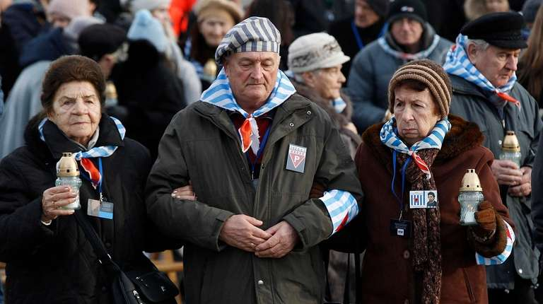 Survivors of Auschwitz arrive at the International Monument