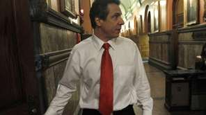Gov. Andrew Cuomo walks into his office at
