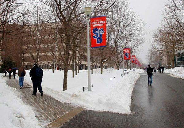 Stony Brook University students walk near the student