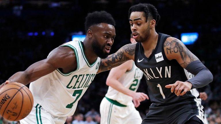 Boston Celtics guard Jaylen Brown (7) drives to