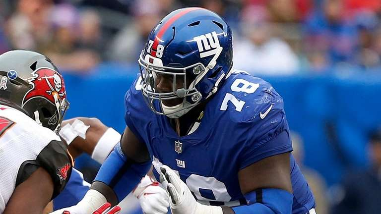 The Giants' Jamon Brown defends against the Buccaneers
