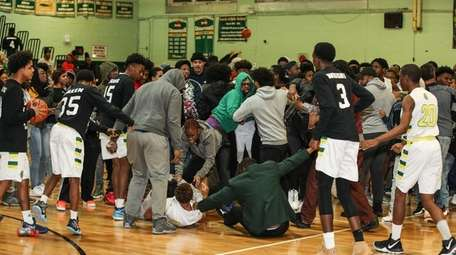 A brawl breaks out after a basketball game