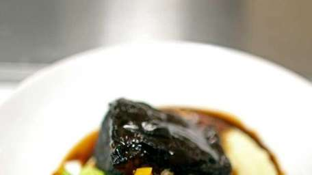 A braised Niman Ranch short rib comes with