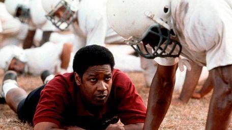 Denzel Washington stars as Coach Herman Boone in