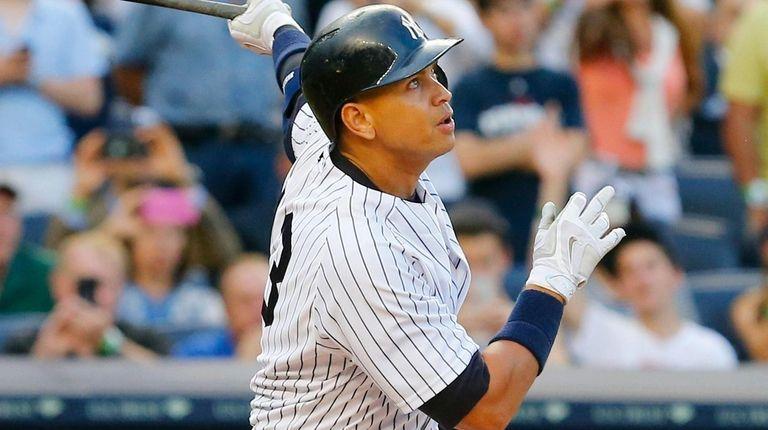 The Yankees' Alex Rodriguez follows through on his
