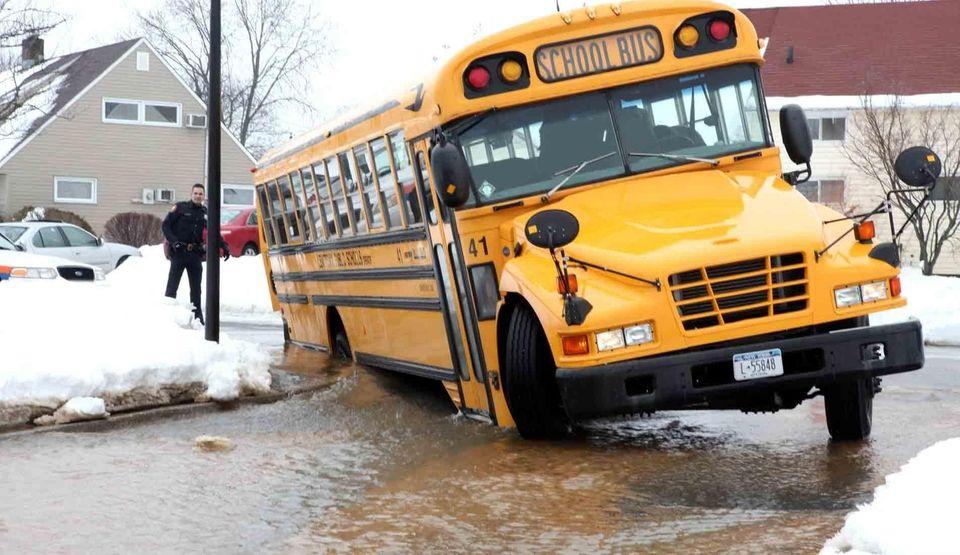 A school bus is stuck in a deep