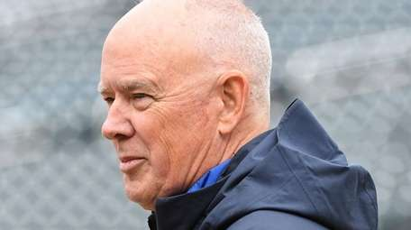 Then-Mets general manager Sandy Alderson looks on during