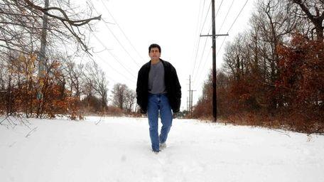 Denis Byrne walks on a hiking trail in