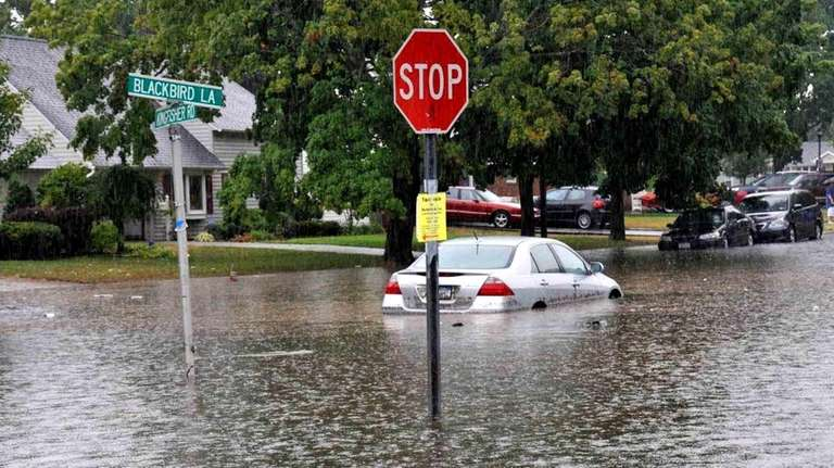 Flooding in Levittown left one car soaked. (July
