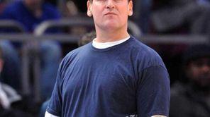 Dallas Mavericks owner Mark Cuban watches warm ups