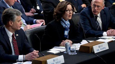 FBI Director Christopher Wray, left, CIA Director Gina